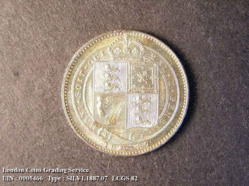 Shilling 1887 Victoria. Jubilee Head dies 1C Medium Garter letters Q has curved looped tail - Reverse
