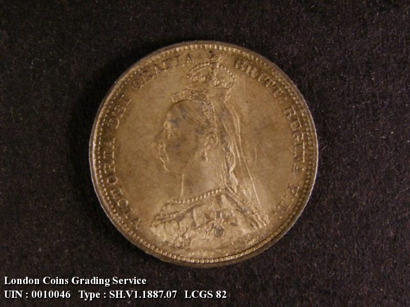 Shilling 1887 Victoria. Jubilee Head dies 1C Medium Garter letters Q has curved looped tail - Obverse